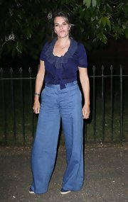 Tracey dressed up her denim with a navy blouse that featured a ruffled neckline.