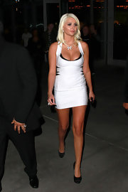 Kristina Shannon paired a micro-mini dress with classic black satin platform pumps.