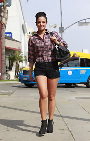 Tulisa Contostavlos chose a pink plaid shirt for her relaxed daytime look.
