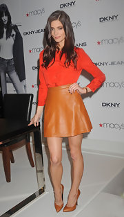 Ashley Greene wore this orange-red blouse to her meet and greet at Macy's.