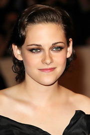 Kristen Stewart wore her short tresses in sleek finger waves at the Costume Institute Gala.