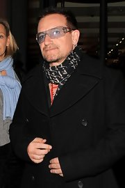 Bono's sporting his signature shield sunglasses. They her a light blue lens with star detail.