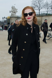 Jessica Chastain opted for a military-inspired, double-breasted coat for her Paris Fashion Week look.