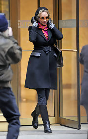 Uma Thurman was spotted on the set of 'Smash' in a modern black wool coat with leather trim.