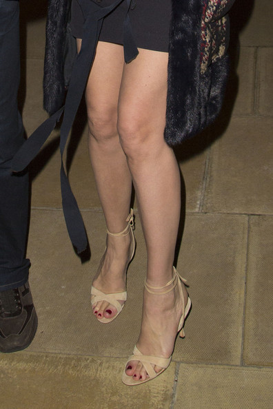 Uma Thurman opted for a pair of nude sandals with ankle ties to complete her evening look while out in London.