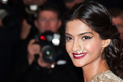 Sonam Kapoor chose berry lipstick to finish off her look with rich color.