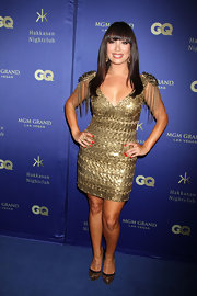 Cheryl Burke looked fab in a gold dress that featured tassled epaulets.