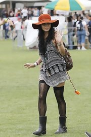 Vanessa Hudgens stepped into a pair of black rain boots featuring straps and buckles while at the Coachella music festival.