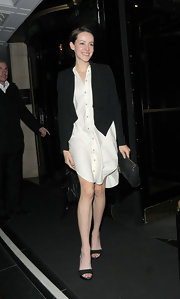 Jena was stylish in a white button-down frock under a draped blazer for her night out.