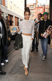 Nothing says summertime quite like all white! Just ask Vanessa, who sported a long-sleeve, knit crop top with a pair of white pants while out in London.
