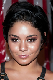 Vanessa Hudgens short, razored haircut could not be more versatile and recreating her look is a breeze. Add a product like Bumble and Bumble Gel to damp hair and finger-comb hair while blow-drying. Lift tresses up or tilt head upside-down to create lots of volume in the crown. To add a soft wave and additional movement, create a slight bend to hair ends with a medium-barreled curling iron.