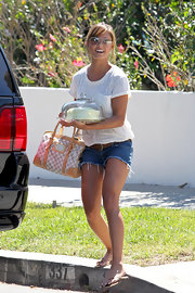 Vanessa paired her cut-off shorts and classic t-shirt with a Damier canvas bag.