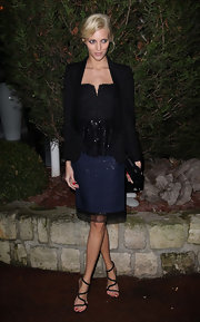 Anja Rubik attended the Sidaction Gala Dinner wearing a black tux jacket over a peplum dress.