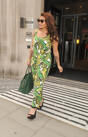 Vanessa's green patterned maxi dress had a playful vibe, perfect for summer.