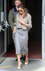 A gray wool skirt topped off Victoria Beckham's look while out at the 'Vogue' Festival.
