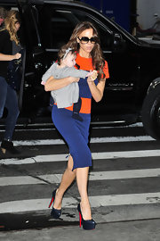 Victoria Beckham toted baby Harper out and about NYC in sky-high platform pumps.