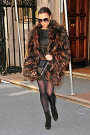 Victoria Beckham dressed for the weather in NYC by wrapping herself in a fluffy amber and brown faux fur coat. She looked chic and cozy as she headed out for a fashion show.
