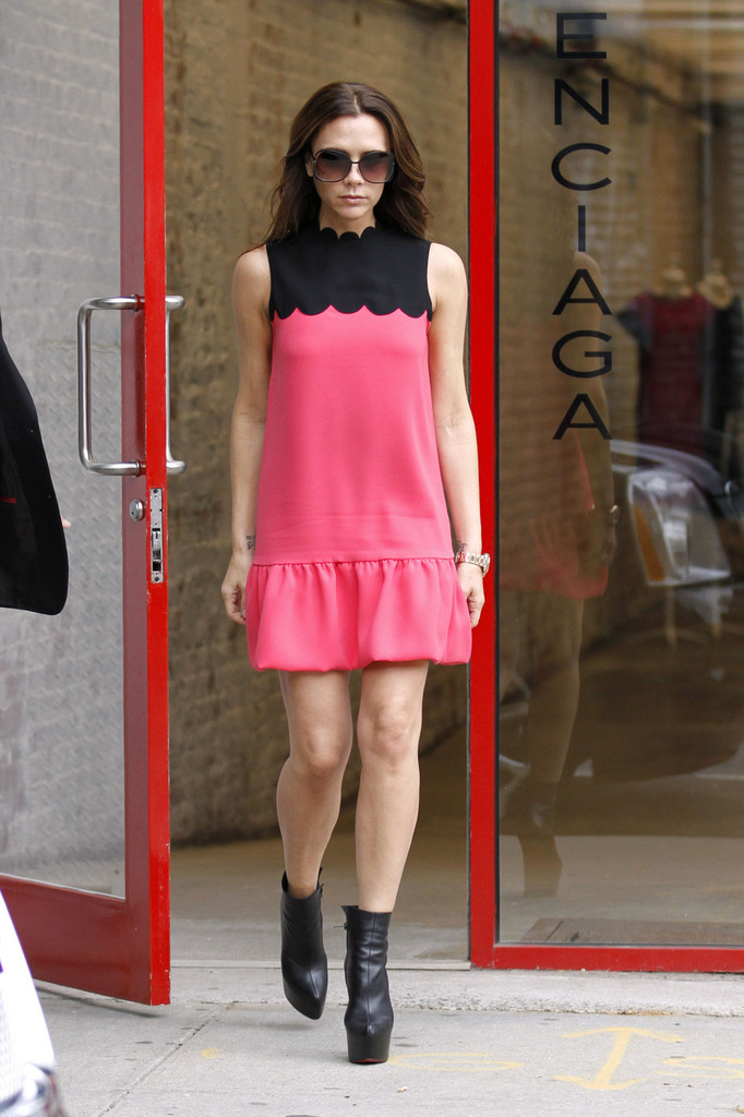Victoria Beckham wears a cute pink dress and leather boots as she goes shopping at the Balenciaga Store in New York. The former Spice Girl is in town to put on a fashion show at Mercedes-Benz Fashion Week.