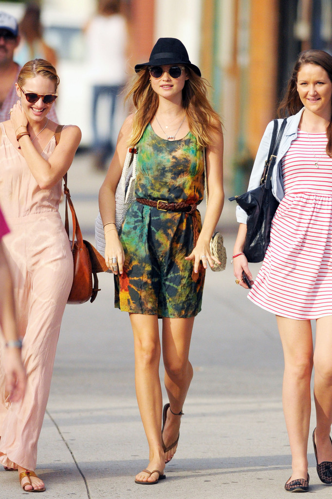 Victoria's Secret model Behati Prinsloo goes for a stroll in New York City wearing a multi-colored summer dress.
