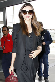 Miranda Kerr strode through LAX wearing her shiny tresses long and straight.