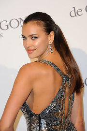 Irina's look is never complete with statement earrings like these.