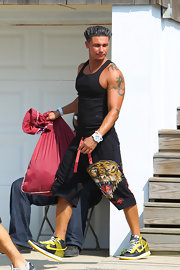 Paul showed off his cool dragon tattoo while leaving the Jersey Shore house.