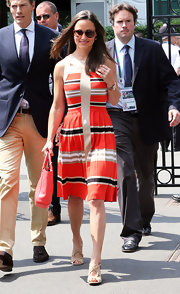 Pippa Middleton went nautical in a striped, pleated dress.