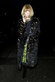 Anna dons a long layered fur coat for Matthew Williamson's London fashion show.