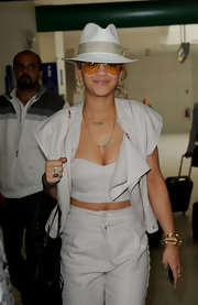 Rita topped off her monochrome ensemble with a matching fedora.