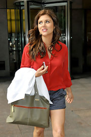 Tiffani Thiessen was out and about in New York City sporting a breezy outfit and carrying a stylish gray leather tote.