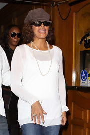 Whitney Houston left a medical building wearing a suede newsboy cap.