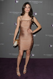 Emmy Rossum looked divine in a pair of strappy gold sandals, which perfectly accentuated her bodycon dress.