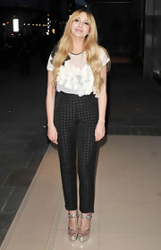 Zara Martin charmed in a pair of high-waist houndstooth pants and a feminine floral blouse.