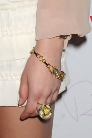Whitney Port paired her white frilly skirt with a vintage green crystal ring.