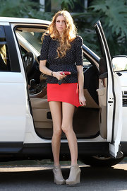 Whitney arrives for a taping of 'Chelsea Lately' in saw-soled wedge ankle boots.