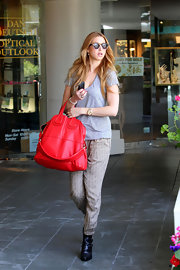 Whitney Port added a dose of color to her all-gray street style with a bright red Nightingale tote.