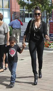 La La Anthony donned a simple yet sophisticated black scoopneck sweater a skinny pants combo at the US Open.
