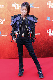 Willow showed off her buckle and lace-up combat boots while walking the red carpet at 'The Karate Kid'.