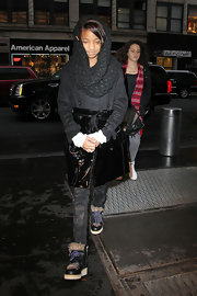 Willow Smith maintained her eclectic signature style with a half wool half patent leather winter coat in NYC.