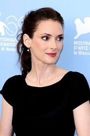 Winona wore her brown waves in a loose ponytail at a photocall in Venice.