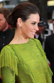 Actress Evangeline Lily showed off her fringe embellished neon dress. Her simple classic bun was the perfect finish to her look.