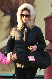 Catherinze Zeta Jones looked glam in cat eye sunglasses and a fur trimmed parka.