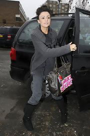 Cher Lloyd was photographed looking comfy chic in a pair of black buckled sheepskin boots.