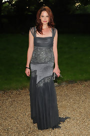 Ruth is chic and sultry in a gunmetal empire gown.