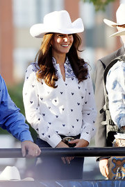 Kate went western in an embroidered white button-down and a cowboy hat for the Calgary Stampede.
