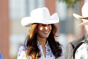 Yee Haw! The Duke and Duchess of Cambridge arrive at the Calgary Stampede, a cherished Canadian tradition, on a 1912 horse-drawn stagecoach.