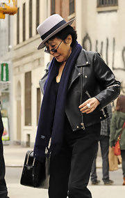 Yoko Ono casually draped a navy scarf with fringe over her neck to keep her from being chilly as she exited Gemma in New York City.