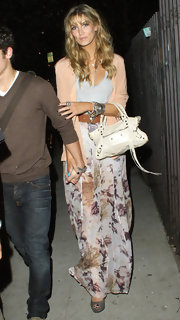 Delta Goodrem accessorized with a chic white Balenciaga biker tote when she watched Adele's concert in Hollywood.