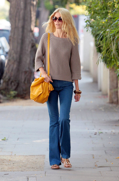 Claudia Schiffer carried a sunny yellow messenger bag with a tassel detail while strolling through Notting Hill.
