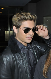 Zac Efron channeled his inner Tom Cruise circa 'Top Gun' in gold aviators and a leather jacket.
